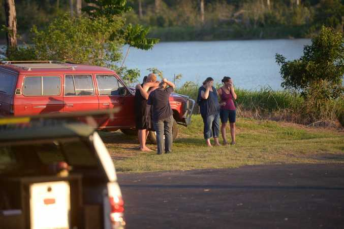 RIVER DEATH: Family members try to come to grips with the tragic scene unfolding before their eyes as a 38-year-old relative died in front of them when she was struck by a jet ski on the Burnett River yesterday. Photo: Max Fleet / NewsMail