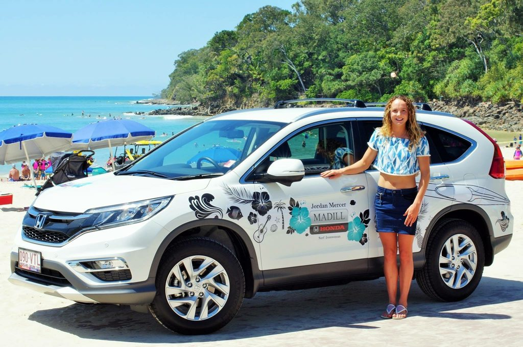 Jordan Mercer with her Honda CR-V at Noosa Main Beach. Photo: Dan Capps