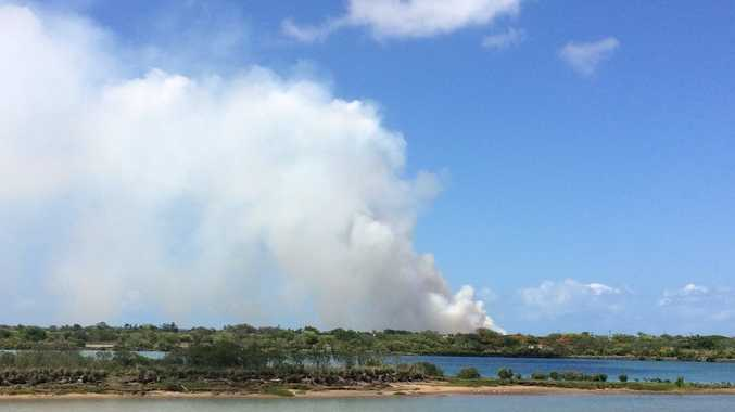 Smoke can be seen from near Caneland Central from a vegetation fire at Slade Point.