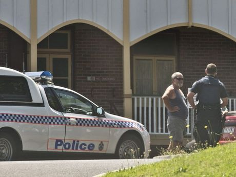 Police search Toowoomba Hospital grounds for a wanted man.
