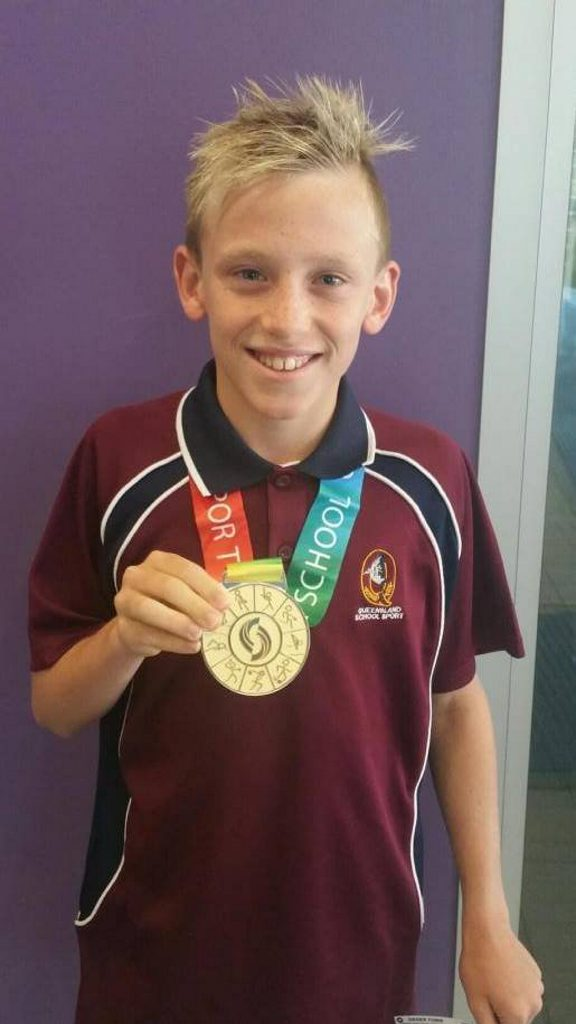 Peyton Craig with his gold medal from the Pacific School Championships in Adelaide this morning.