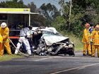 TRAPPED: This head-on crash at McKees Hill closed the Bruxner Hwy for more than two hours yesterday. The 19-year-old driver of the Commodore (pictured) was pinned in his car and seriously injured.