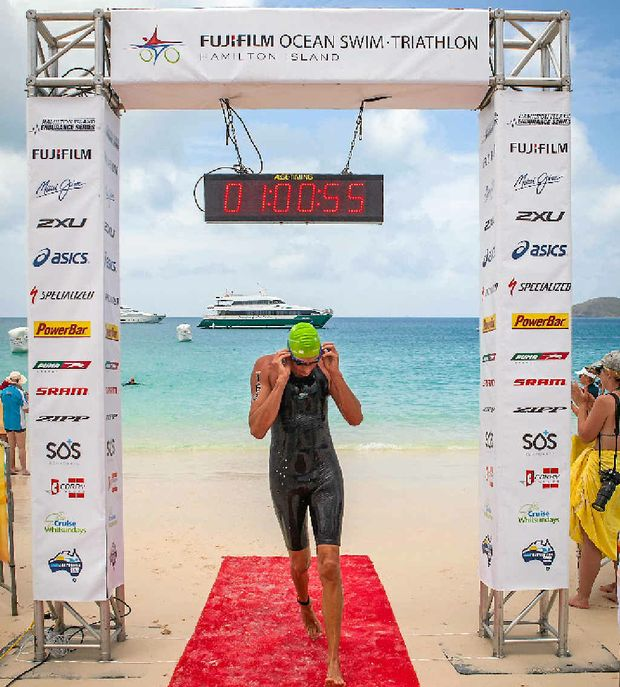 SWIM SPRINT: Matt Pegg crosses the line to win the Whitehaven Beach Ocean Swim on Sunday morning.