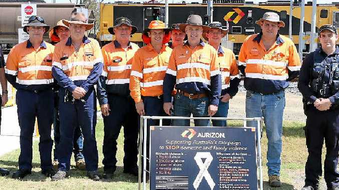 UNITED STAND: White Ribbon Day supporters Constable Dale Cook (Gracemere Police), recruit Marcus Witt, Aurizon regional general manager Peter Cowan and Aurizon staff photographed at the Stanwell Aurizon Depot for Domestic Violence Awareness Month.