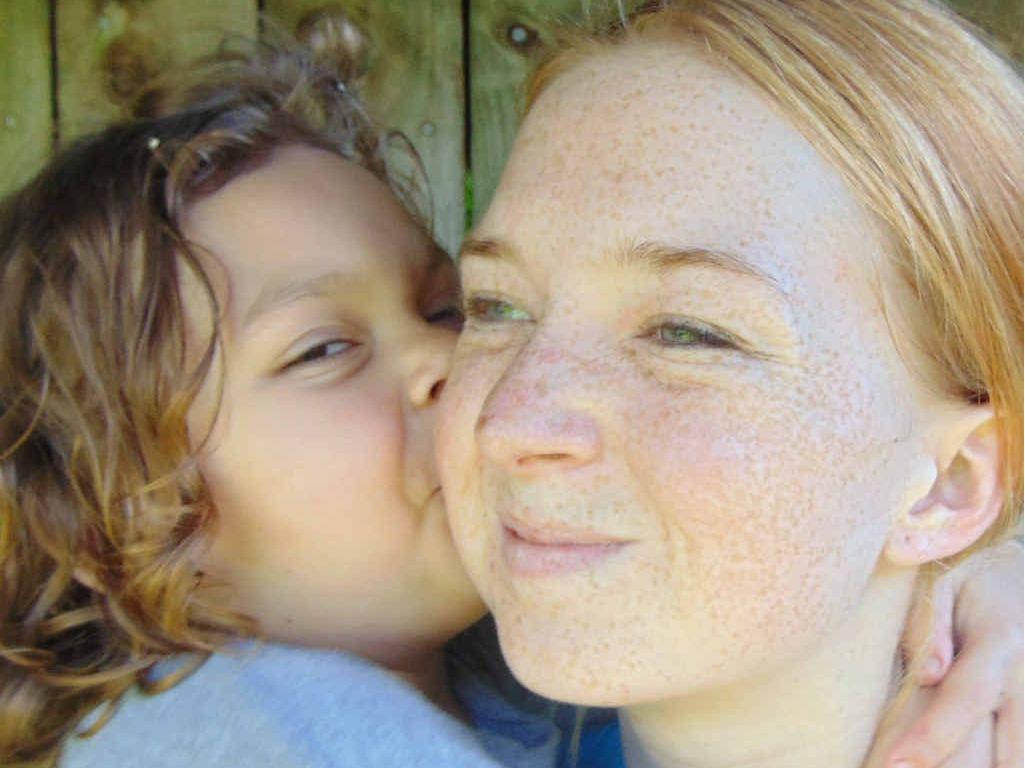 KISS OF LIFE: Young mum Alisha Garlick gets a kiss from her daughter, Kamaya, 3.