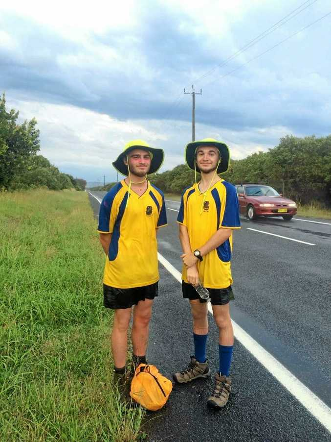 TOP MARKS: Schoolies Alexi Piovano and Adam Hegedus on the road as they walk from Bondi to Byron Bay to raise money for a school in Timor-Leste.