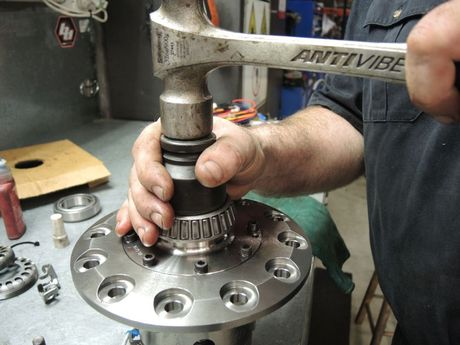 The new bearings need a precise fitment, that's a highly calibrated hammer he's working with