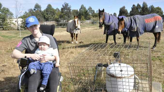 Oakey resident Kristy Banks, with son Nash Groves, is concerned their bore water may be contaminated by chemicals used in firefighting driills at the nearby Oakey Army Aviation Training Centre.Photo: Stuart Cumming / The Chronicle