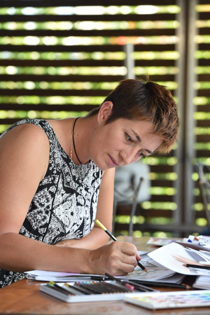 Amber Bates working on her drawings at home in Maryborough. Photo: Alistair Brightman / Fraser Coast Chronicle