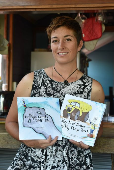 Amber Bates with her childrens books. Photo: Alistair Brightman / Fraser Coast Chronicle