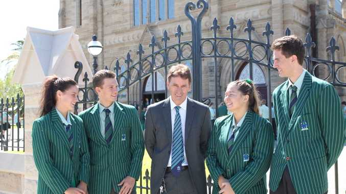 TCC teacher Steve Parle with 2015 Year 12 graduates. Photo: Contributed