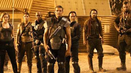 Matt Nable, centre, in a scene from the movie Riddick.