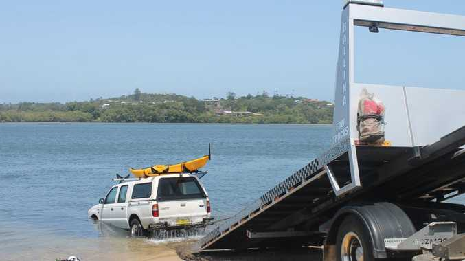 UNUSUAL CATCH: A 4WD vehicle is retrieved from North Creek at the Cawarra St boat ramp in Ballina. Photo Graham Broadhead / Ballina Shire Advocate