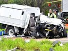 Emergency services inspect a white ute that was involved in the fatal crash on the Bruce Hwy at Bells Creek.