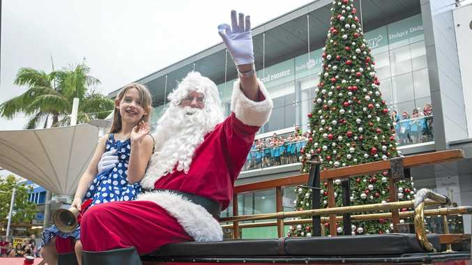 Santa with Julie Ellem, the winner of last year's tree decoration competition. The winner of the 2015 design competition will be revealed today.