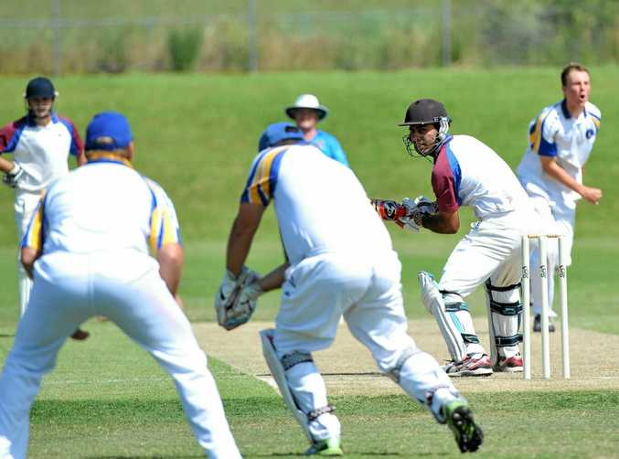 Diggers' bat Raj Sandhu is surrounded by blue caps in the the last meeting with Sawtell.