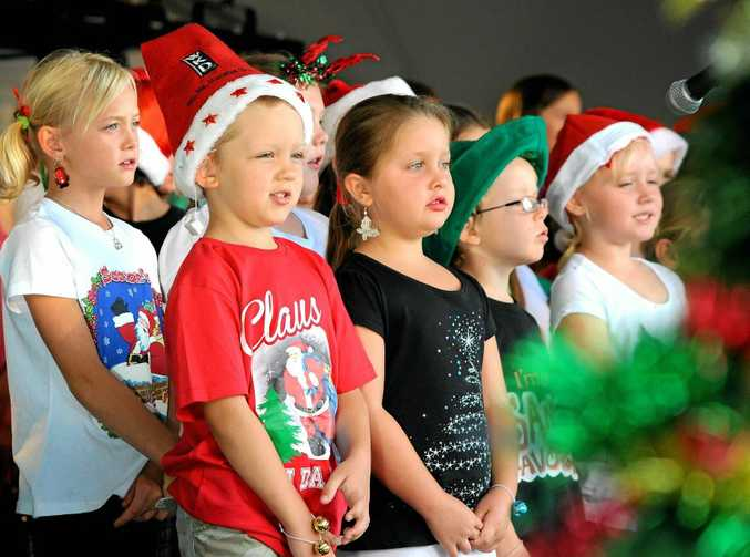 Singing carols is Nana Glen Public School choir at the Carols by Candlelight held at the Coff Racing club.  Photo: Leigh Jensen / Coffs Coast Advocate