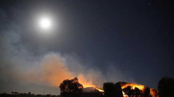 A burning hay shed in moonlight near Roseworthy in South Australia. Photo: Carl Saville