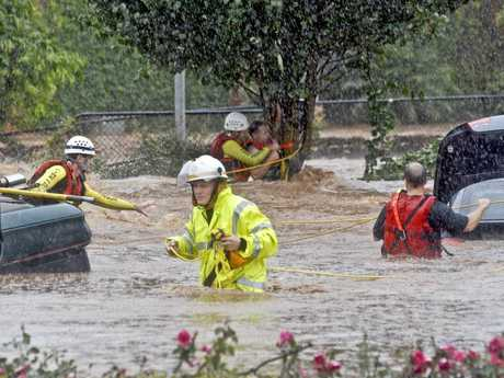 Swift water rescue team at work in flooded Dent St during January 2011 floods.