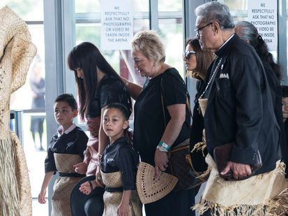 Nadene Lomu and her children Dhyreille and Brayley follow Jonah's casket into the service. Photo / Jason Oxenham