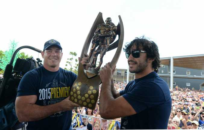 Cowboys captains Matt Scott and Johnathan Thurston hold the NRL premiership trophy up for Mackay fans at the Bluewater Quay. Photo Lee Constable / Daily Mercury