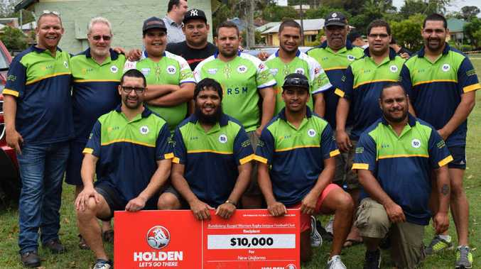 WINNERS: Members of the Bundjalung Baygal Warriors Rugby League Football Club accept a $10,000 cheque from Holden's Lismore representative Andrew Latimer (inset). The money will be used to purchase new uniforms and equipment.