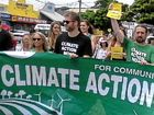 TARGET SET: Greens candidate for Richmond, Dawn Walker (left), joined the Climate Rally in Byron Bay yesterday.