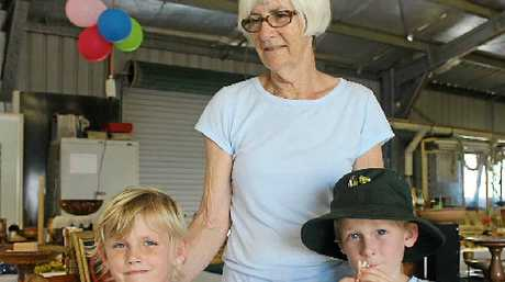 Lenore Myers and her grandchildren Lily and Alexander Myers watched woodturning demonstrations.