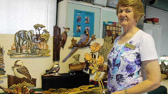 MACKAY TALENT: Fay Wassell holding some of her stunning intarsia work at the woodturners' Christmas display.
