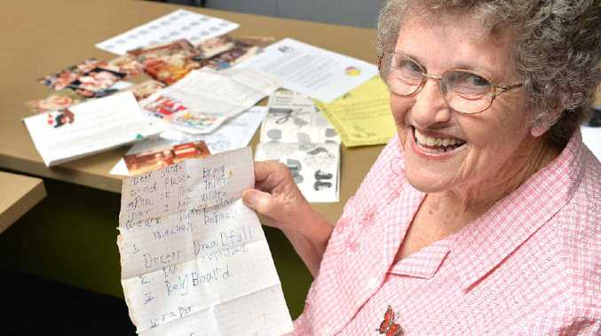 MEMORIES: Former Bucasia Postie, Marie Murray, with some of the letters and pictures of Christmas celebrations dating back to the mid-1970s. INSETS: Mercury Editor Meredith Papavasiliou, with Mrs Murray, ready to send a letter to Santa just like she did as a little girl growing up in Bucasia; and (above) the old post box.