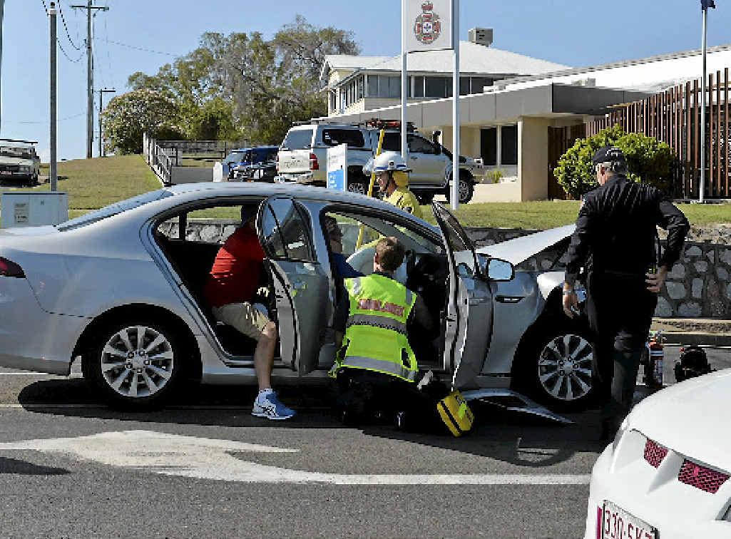 Paramedics work at the scene of Thursday's two-car crash.