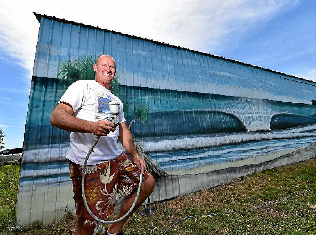READY TO HELP: Artist Owen Cavanagh has already re-painted the mural along the Sunshine Mwy once after vandals sprayed it with graffiti.