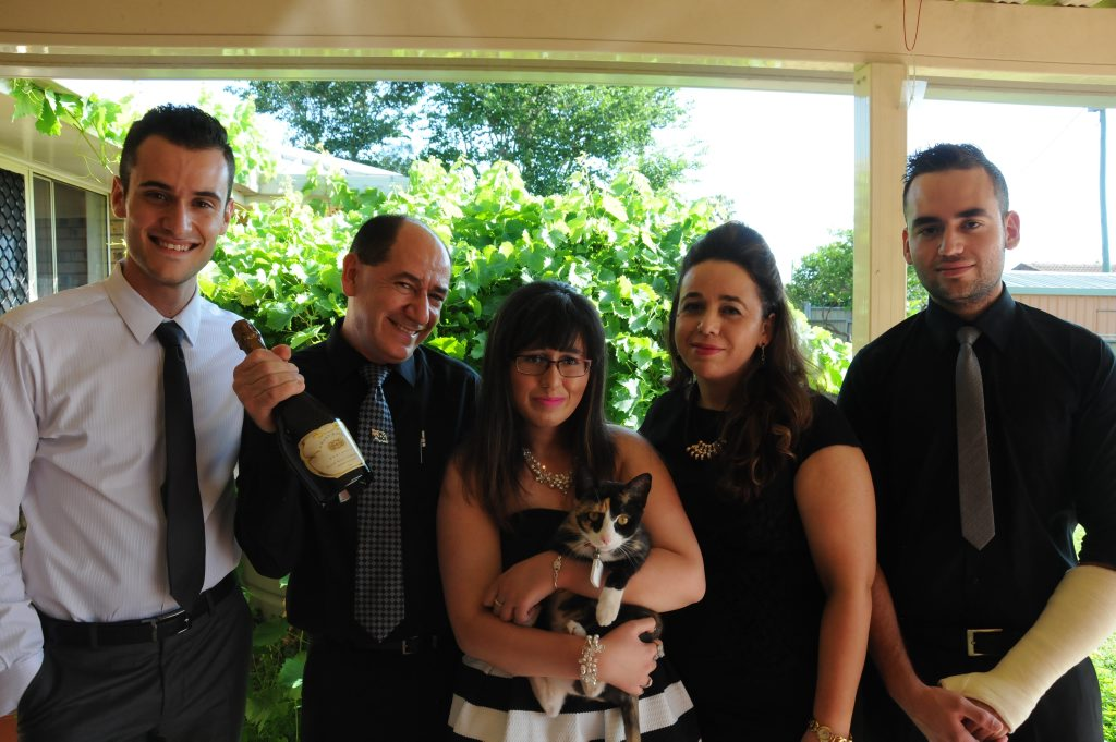 Celebrating their new citizenships are Adrian, Ambrozio, Sonia, Flake the cat, Manuela and Roberto Da Silva.