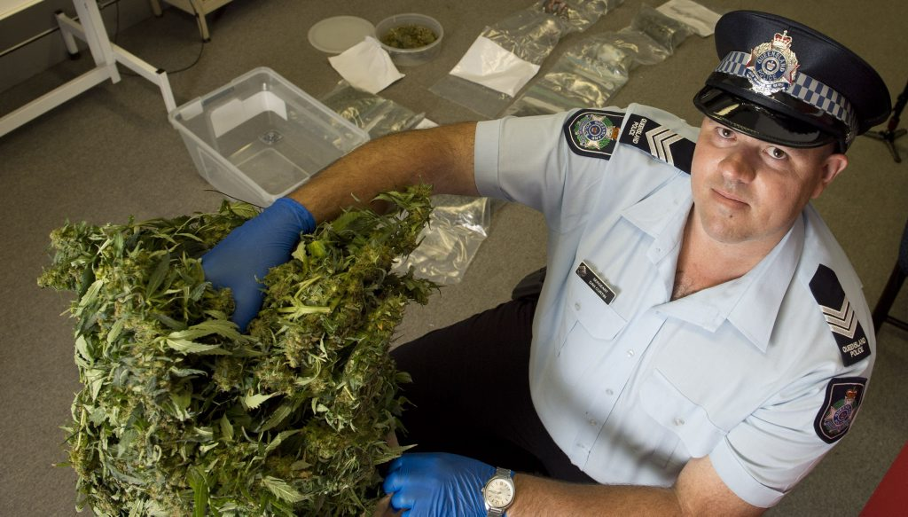Sergeant Dan Curtin with a drug haul at Toowoomba Police Station.