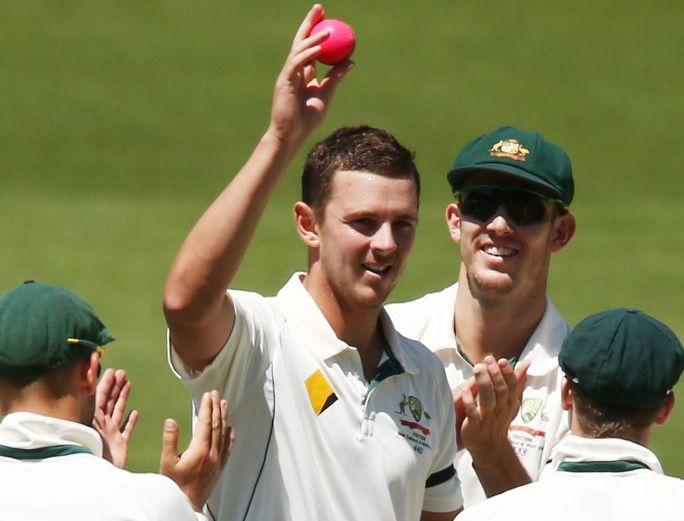 Centre of attention: Josh Hazlewood after claiming his fifth wicket yesterday at the Adelaide Oval. Photo: Getty Images.