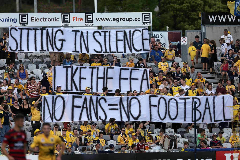 Mariners fans hold up a sign during the round eight A-League match between the Central Coast Mariners and the Western Sydney Wanderers at Central Coast Stadium in Gosford. Photo: Ashley Feder/Getty Images.