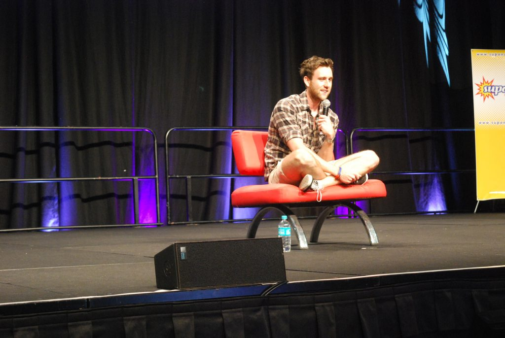 Matthew Lewis (Neville Longbottom from Harry Potter) speaks at a live panel for fans.