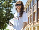 A volunteer from activist group GetUp! hands out how-to-vote cards.