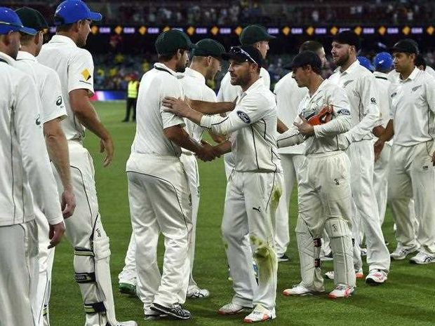 New Zealand's captain Brendon McCullum (C) shakes hands with Australian players at the end of the first day-night cricket Test match at the Adelaide Oval on November 29, 2015.