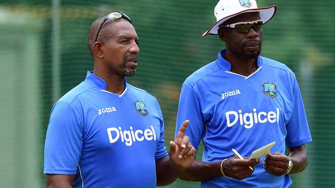 Phil Simmons chats with Curtley Ambrose at West Indies training in Brisbane. Photo: AAP Image.