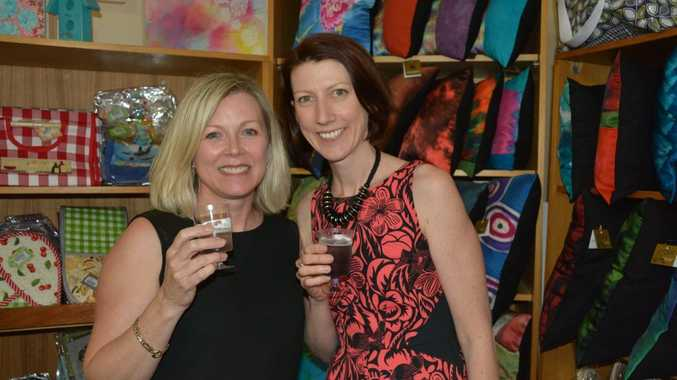 Ally Martell and Kristy Hayes enjoy a glass of lavender bubbly while checking out the gifts on offer. Bush Christmas Exhibition 2014 official opening. Photo Tara Miko / The Chronicle