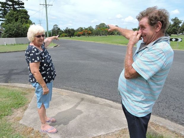 KICKING UP A STINK: Paula and Howard Davis point towards the area where the strong smell of fertiliser is coming from in Granville.
