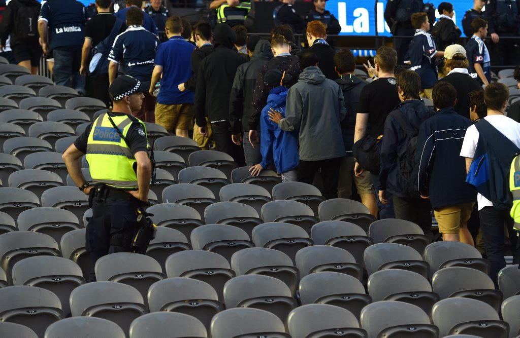 Victory fans walk out en masse at the 30th minute in protest during the Melbourne Victory and Adelaide United round 8 match at Etihad Stadium in Melbourne. Photo: AAP Image/Tracey Nearmy.