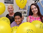FOR THE KIDS: Bundaberg Health Services Foundation manager Maria Burnet and Sea FM Tactics and Integration manager Estelle Pretorius and children's ward patient Sio Akua celebrate.