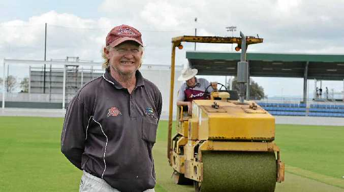 IMPORTANT ROLE: Harrup Park curator Bruce Bridger gets some help to prepare the pitch from Ross Harris ahead of the Sheffield Shield match.