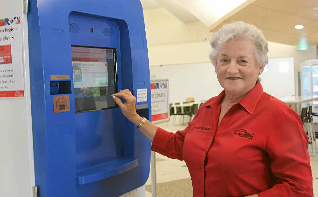 AUSTRALIAN FIRST: Cr Rose Swadling tests out the new library unit at the Rockhampton Airport.