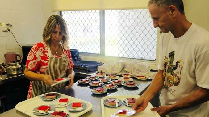 IN PRODUCTION: Jodie and David prepare meals in the Uniting Church soup kitchen.