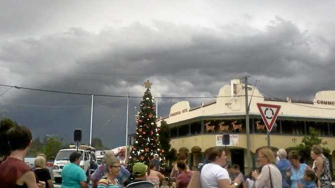 LOOMING STORM: The Casino Christmas Street Party still went ahead last week despite the threat of surrounding thunderstorms. Full story and pics on Page 10.  Photo Samantha Elley / Express Examiner
