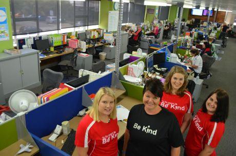 Lauren Alsemgeest, Jo Shanks, Ashleigh Gillham and Emily Birditt model the shirts around the office. Photo Troy Kippen / Daily Mercury