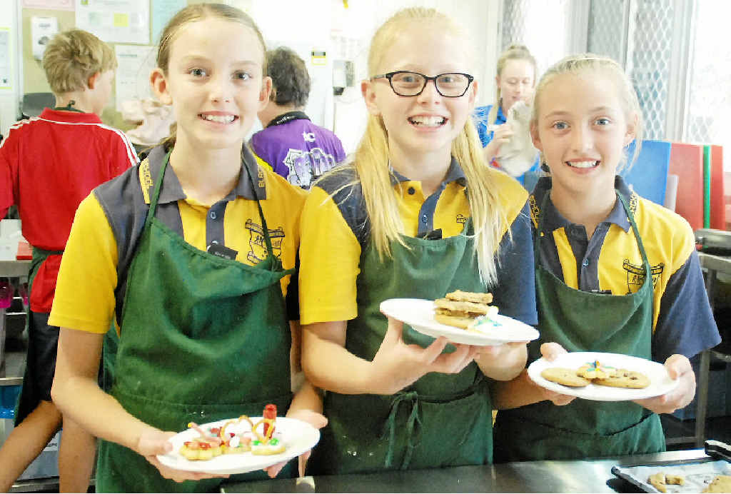 COOKIE CUTTERS: Blackwater North State School Year 6 students Jada Broderick, Delaney Window and Amber Lancaster test their skills in the home economics kitchen.